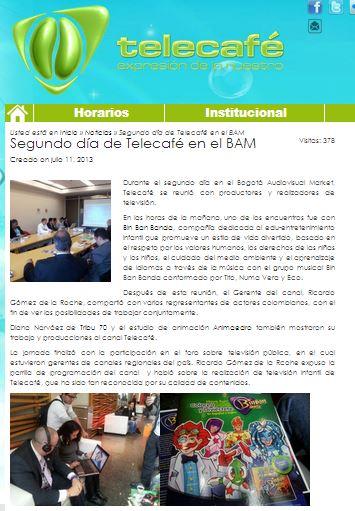 Yenny Santamaría presentando Camusi Camusi al Gerente de Telecafé, Ricardo Gómez de la Roche